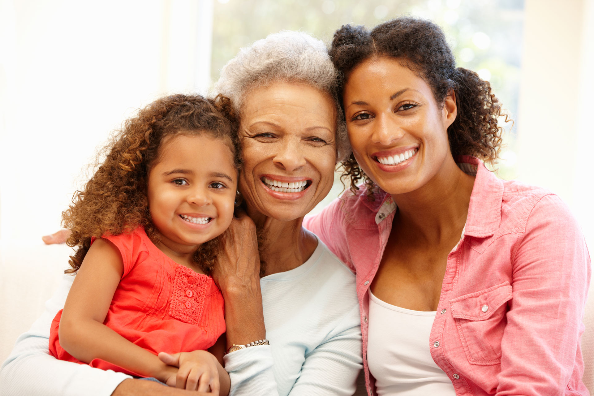 Grandmother, mother and child together smiling